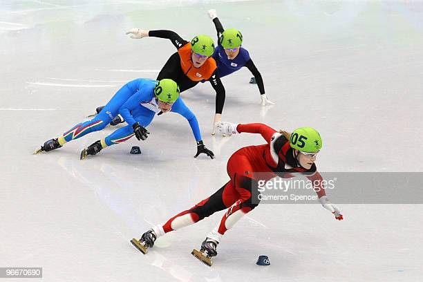 Jessica Gregg of Canada leads the pack in the Ladies' 500 m Short Track on day 2 of the Vancouver 2010 Winter Olympics at Pacific Coliseum on...