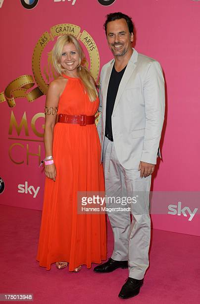 Jessica GruesserBoers and her husband Marcus Gruesser attend the MGM HD CHANNEL Hollywood Sunset Party on July 29 2013 in Munich Germany