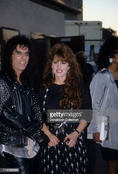 Jessica Hahn and Alice Cooper pose for a portrait in 1989 in Los Angeles California