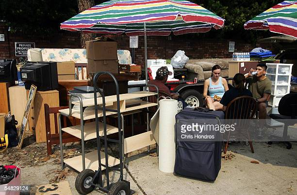 Jessica Hahn and her boyfriend Gabriel Montoya sit with relatives outside the couple's apartment September 5 2005 in Metairie Louisiana Hahn and...
