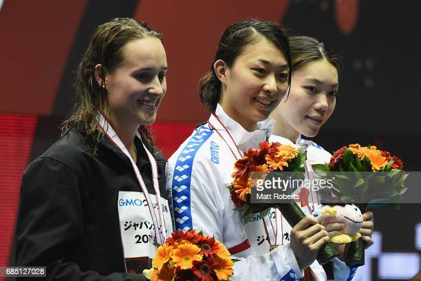 Jessica Hansen of Australia Satomi Suzuki of Japan and Reona Aoki of Japan pose with their medals on the podium during the Japan Open 2017 at Tokyo...