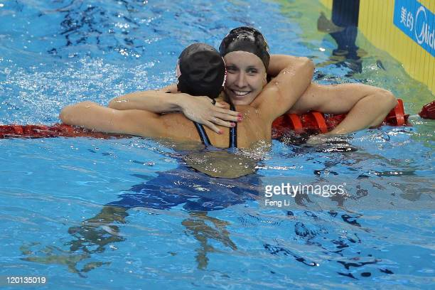 Jessica Hardy of the United States is congratulated by team mate and bronze medalist Rebecca Soni after winning the gold medal in the Women's 50m...