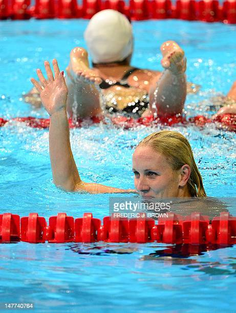 Jessica Hardy waves to the crowd following her first place finish in the women's 50M Freestyle final on the last day of the 2012 US Olympic Team...
