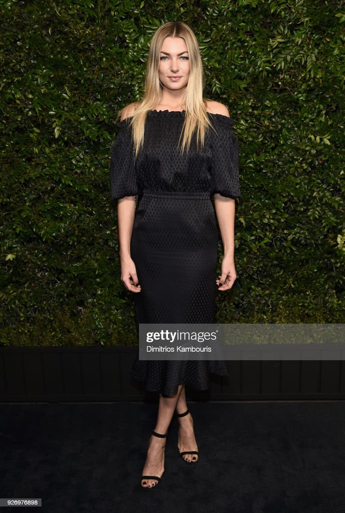 Jessica Hart, wearing CHANEL, attends Charles Finch and Chanel Pre-Oscar Awards Dinner at Madeo in Beverly Hills on March 3, 2018 in Beverly Hills, California.