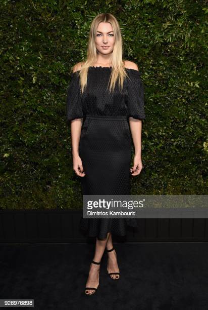 Jessica Hart wearing CHANEL attends Charles Finch and Chanel PreOscar Awards Dinner at Madeo in Beverly Hills on March 3 2018 in Beverly Hills...