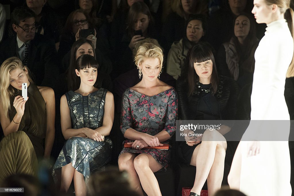 Jessica Heart, Jena Malone and Katherine Heigl watch the J. Mendel Fall 2013 Mercedes-Benz Fashion Show at The Theater at Lincoln Center on February 13, 2013 in New York City.