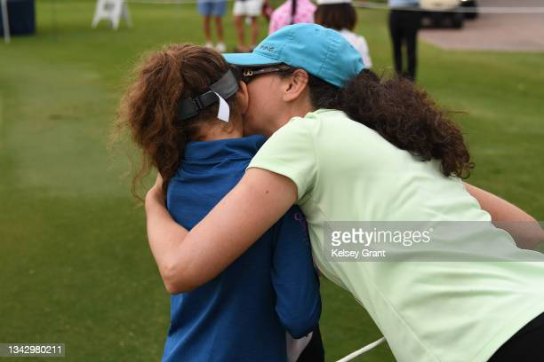 Jessica Hoerr of the girls 7-9 category gets a kiss from her mother during the 2021 Drive, Chip and Putt Regional Qualifier at TPC Scottsdale on...