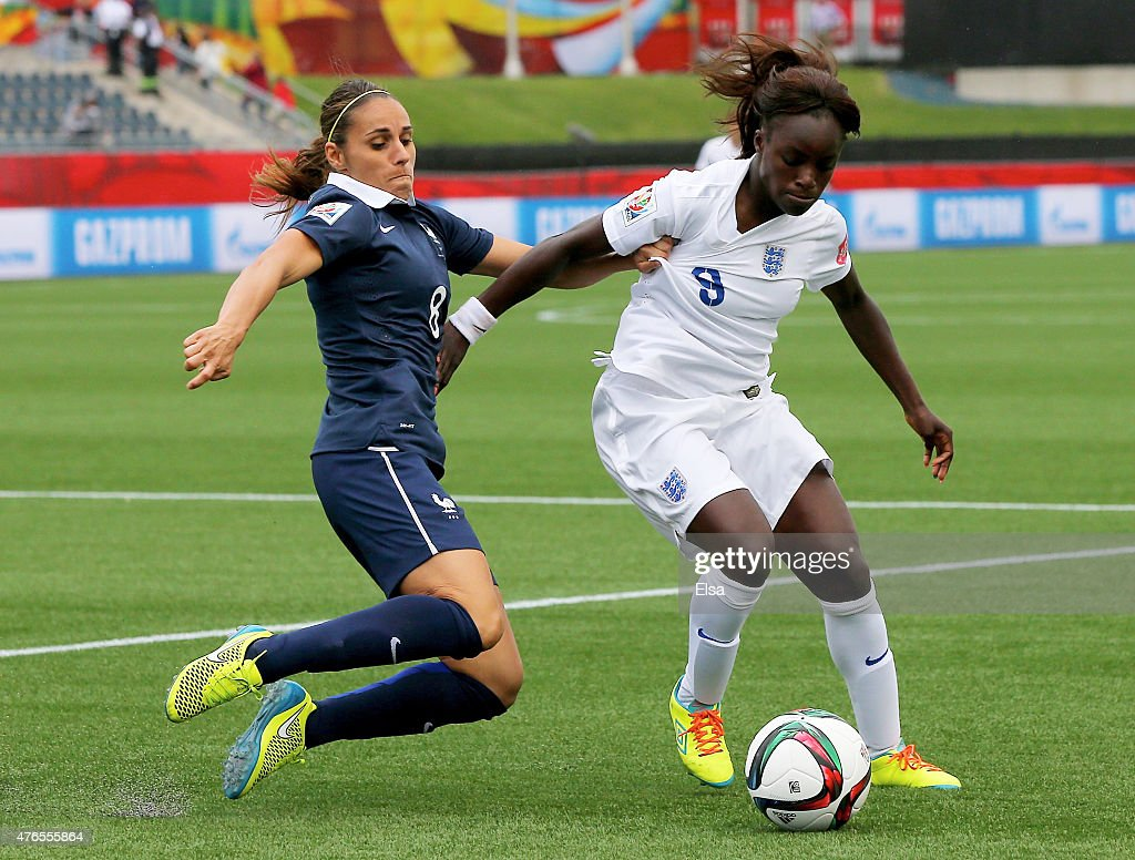 Jessica Houara #8 of France and Eniola Aluko #9 of England fight for the ball in the first half during the FIFA Women's World Cup 2015 Group F match at Moncton Stadium on June 9, 2015 in Moncton, Canada.