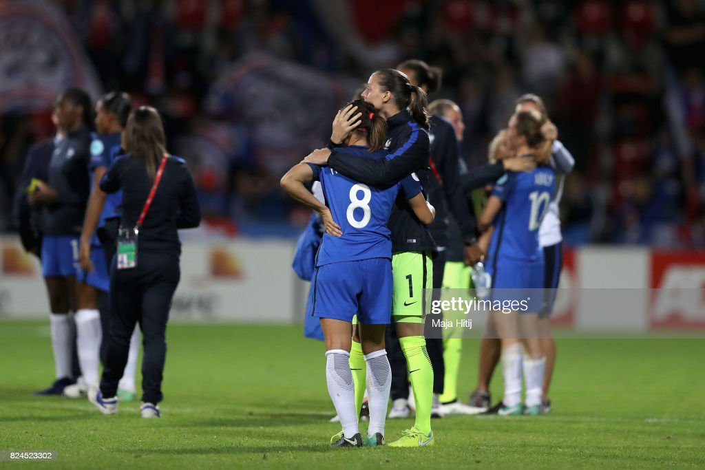 Jessica Houara-D'Hommeaux of France and Laetitia Philippe of France embrace after the UEFA Women's Euro 2017 Quarter Final match between France and England at Stadion De Adelaarshorst on July 30, 2017 in Deventer, Netherlands.