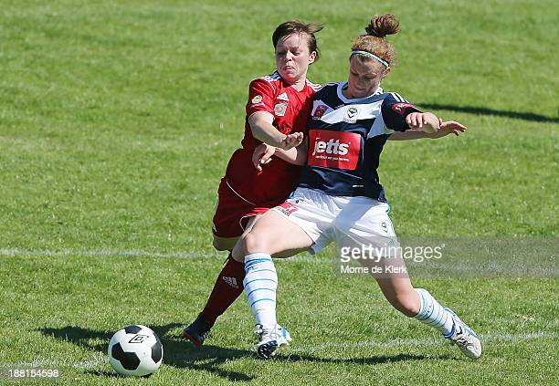 Jessica Humble of Victory competes for the ball with LisaMarie Woods of Adelaide during the round two WLeague match between Adelaide and Melbourne at...