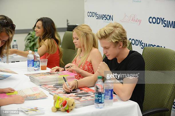 Cody simpson meet and greet at genesco park stock photos and jessica jarrell allie simpson and cody simpson sign autographs during a meet and greet at genesco m4hsunfo