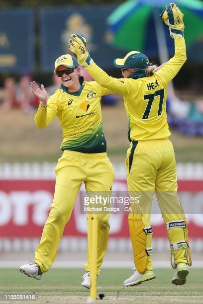 Jessica Jonassen of Australia celebrates her run out of Amy Satterthwaite of New Zealand of Alyssa Healy during game three of the One Day...
