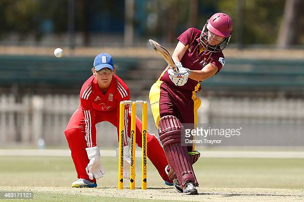 Jessica Jonassen of Queensland bats as wicketkeeper Amy Jones of England looks on during the International Tour match between the Chairman's XI and...