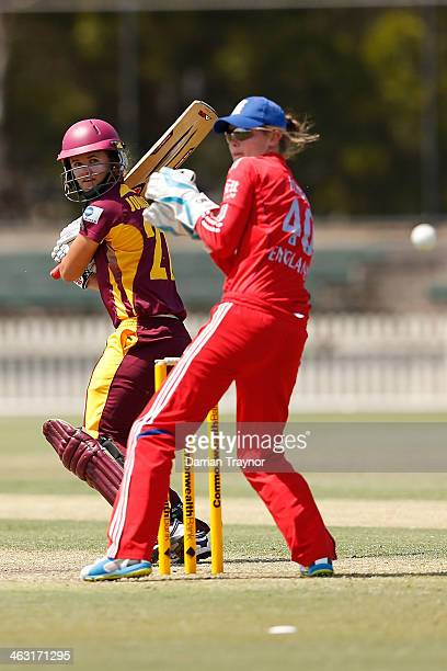 Jessica Jonassen of Queensland plays a late cut past wicketkeeper Amy Jones of England during the International Tour match between the Chairman's XI...