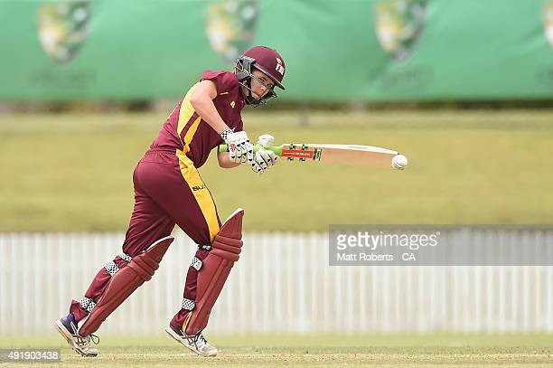 Jessica Jonassen of the Fire bats during the round one WNCL match between Queensland and Victoria at Allan Border Field on October 9 2015 in Brisbane...