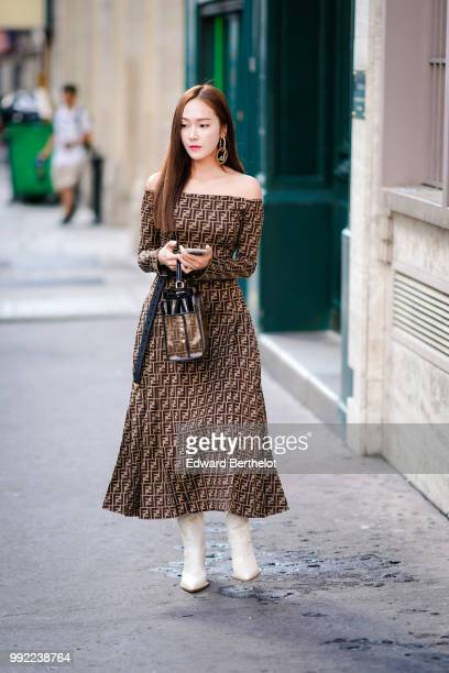 Jessica Jung wears a Fendi brown dress outside Fendi during Paris Fashion Week Haute Couture Fall Winter 2018/2019 on July 4 2018 in Paris France