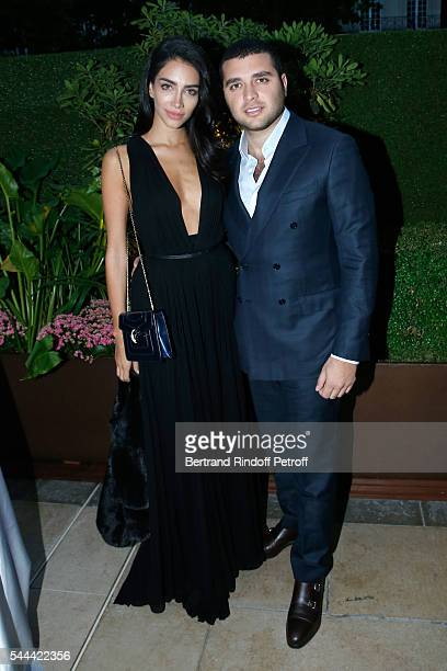 Jessica Kahawaty and Elie Saab Jr attend the Amfar Paris Dinner Stars gather for Amfar during the Haute Couture Week Held at The Peninsula Hotel on...