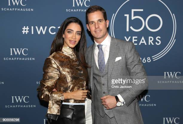 Jessica Kahawaty and IWC Schaffhausen CEO Christoph GraingerHerr at the IWC booth during the Maison's launch of its Jubilee Collection at the Salon...
