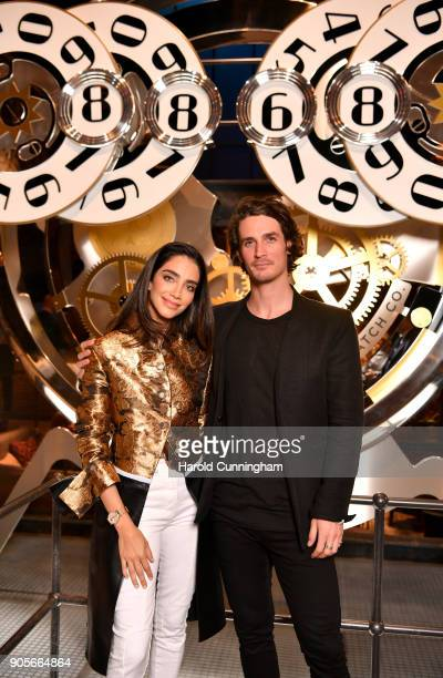 Jessica Kahawaty and Patrick Seabase visit the IWC booth during the Maison's launch of its Jubilee Collection at the Salon International de la Haute...