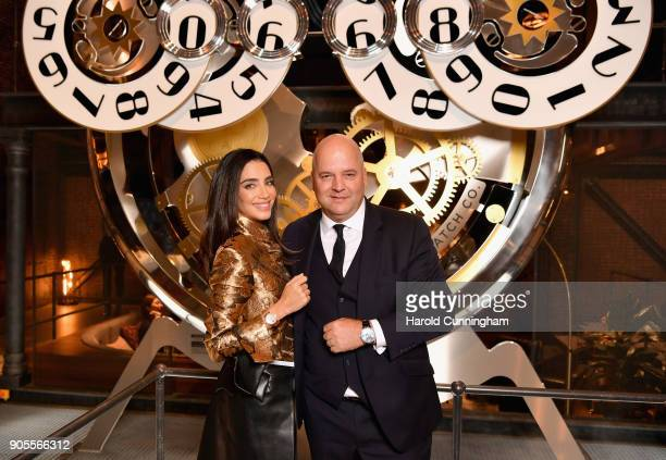 Jessica Kahawaty and Regional Brand Director Luc Rochereau visit the IWC booth during the Maison's launch of its Jubilee Collection at the Salon...