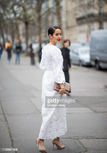 Jessica Kahawaty is seen wearing white dress outside Valentino during Paris Fashion Week Womenswear Fall/Winter 2019/2020 on March 03 2019 in Paris...