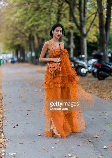 Jessica Kahawaty is wearing an orange dress and Chloe bag outside Chloe on September 29 2016 in Paris France