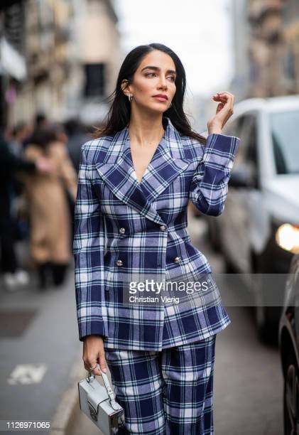 Jessica Kahawaty wearing plaid suit attends the Ermanno Scervino show at Milan Fashion Week Autumn/Winter 2019/20 on February 23 2019 in Milan Italy