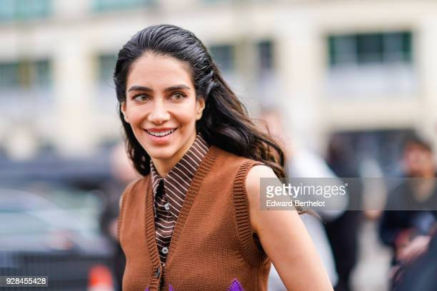 Jessica Kahawaty wears a shirt outside Miu Miu during Paris Fashion Week Womenswear Fall/Winter 2018/2019 on March 6 2018 in Paris France