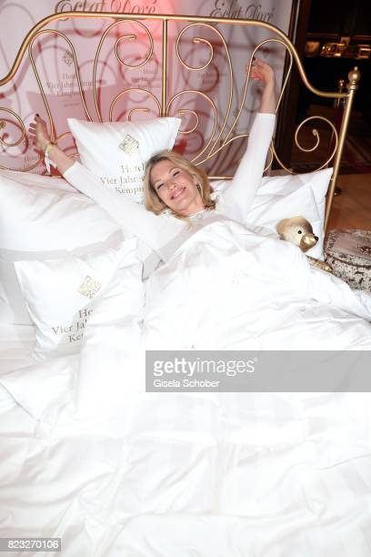 Jessica Kastrop in bed during the Hotel Vier Jahreszeiten summer party 'Eclat Dore' on July 26, 2017 in Munich, Germany.
