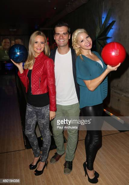 Jessica Kinni Ben Decker and Anne McDaniels attend the 'Unlikely Heroes' bowling luncheon at Lucky Strike Bowling Alley on November 16 2013 in...