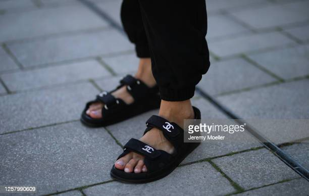 Jessica Knura wearing Chanel sandals and Cotton Citizens pants on July 24, 2020 in Cologne, Germany.