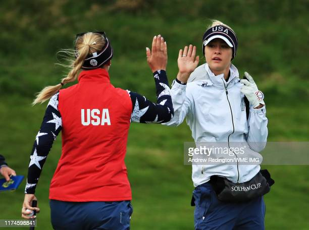 Jessica Korda and Nelly Korda of Team USA high five on the first green during Day 2 of the Solheim Cup at Gleneagles on September 14 2019 in...