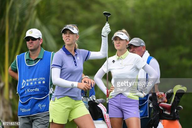 Jessica Korda and Nelly Korda of United States play a shot on the 14th hole during the second round of the Blue Bay LPGA at Jian Lake Blue Bay golf...