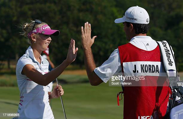 Jessica Korda celebrates a par saving putt on the 14th green with her caddie/boyfriend Johnny DelPrete during the third round of the 2013 US Women's...