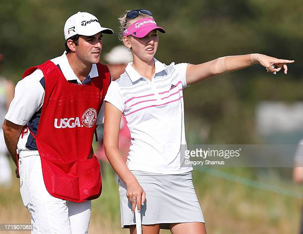 Jessica Korda discusses a putt on the 16th green to her caddie/boyfriend Johnny DelPrete during the third round of the 2013 US Women's Open at...