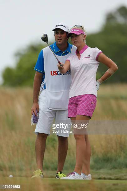Jessica Korda lines up her tee shot on the 15th hole with her boyfriend/caddie Johnny DelPrete during the final round of the 2013 US Women's Open at...