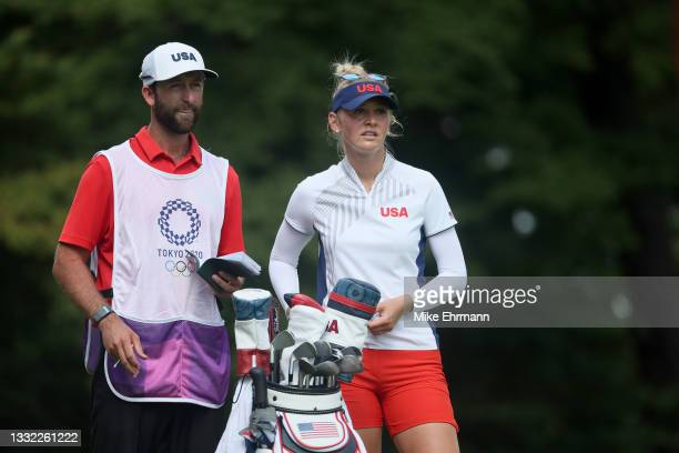 Jessica Korda of Team United States and caddie Kyle Morrison wait on the 18th tee during the first round of the Women's Individual Stroke Play on day...