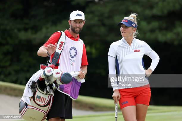 Jessica Korda of Team United States talks with caddie Kyle Morrison on the 17th green during the first round of the Women's Individual Stroke Play on...