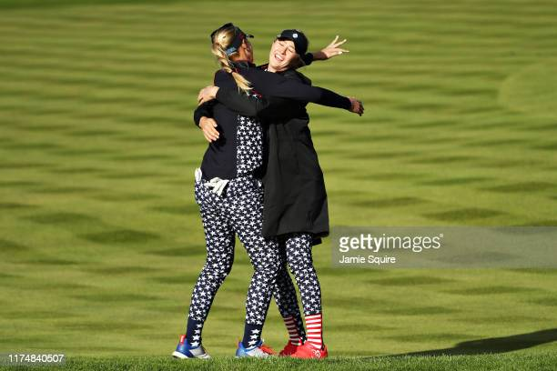 Jessica Korda of Team USA celebrates winning her match with Caroline Masson of Team Europe by hugging her sister teammate Nelly Korda on the...