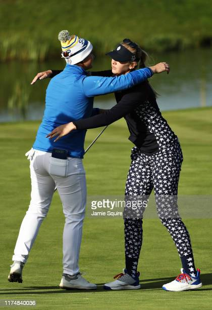 Jessica Korda of Team USA hugs Caroline Masson of Team Europe after winning their match on the sixteenth hole during the final day singles matches of...