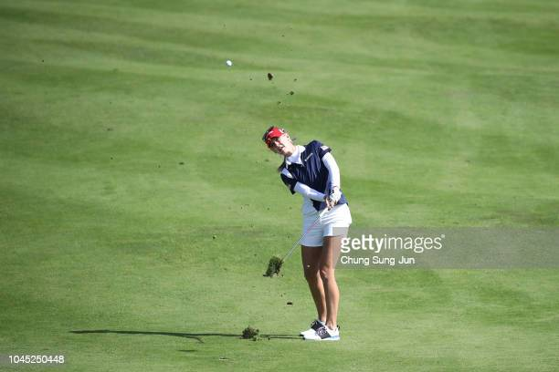 Jessica Korda of the United States hits her second shot on the first hole in the Pool B match between United States and Sweden on day one of the UL...