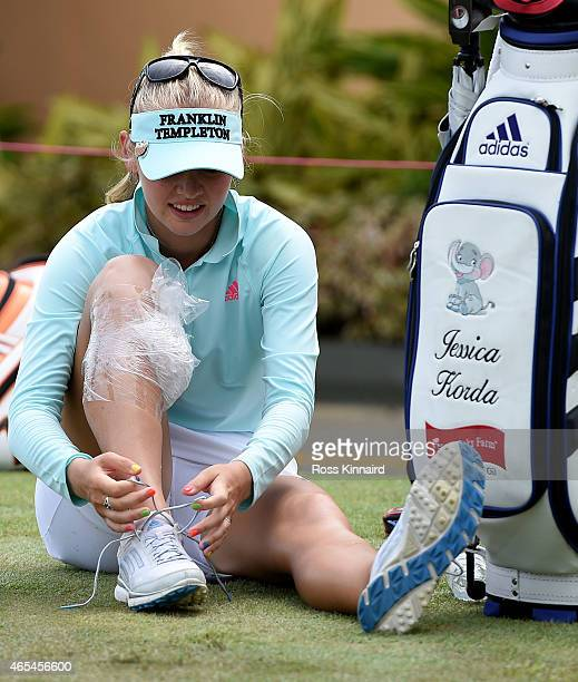 Jessica Korda of the USA with her knee in an ice pack on the practice putting green during the third round of the HSBC Women's Champions at the...