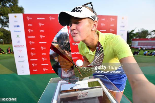 Jessica Korda of United States imitates taking a selfie photo with her trophy after winning the Honda LPGA Thailand at Siam Country Club on February...