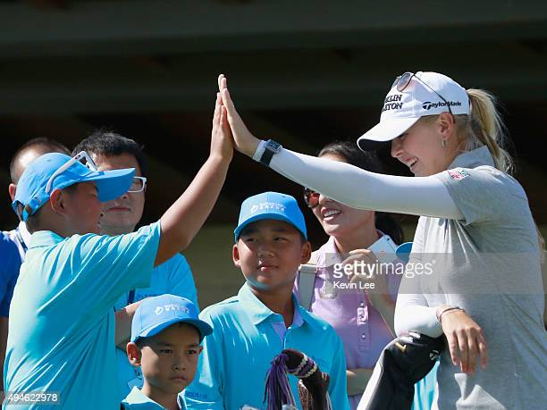 Jessica Korda of United States interacts with kids in a golf clinic on Day 3 of Blue Bay LPGA 2015 at Jian Lake Blue Bay golf course on October 28...