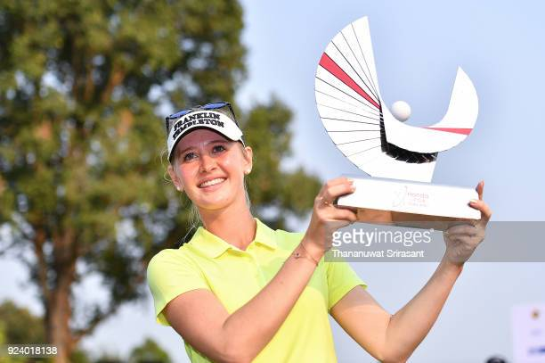 Jessica Korda of United States poses with the trophy on the 18th green after winning the Honda LPGA Thailand at Siam Country Club on February 25 2018...