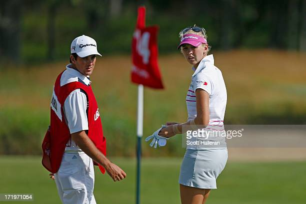 Jessica Korda waits on the 14th green with her caddie/boyfriend Johnny DelPrete during the third round of the 2013 US Women's Open at Sebonack Golf...