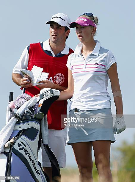 Jessica Korda waits on the 15th tee with her caddie/boyfriend Johnny DelPrete during the third round of the 2013 US Women's Open at Sebonack Golf...