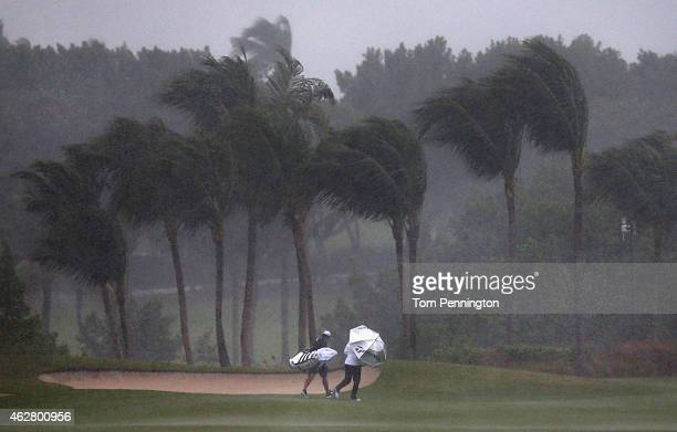 Jessica Korda walks off the course after a rain storm forced the round to be stopped during round one of the Pure Silk Bahamas LPGA Classic at the...