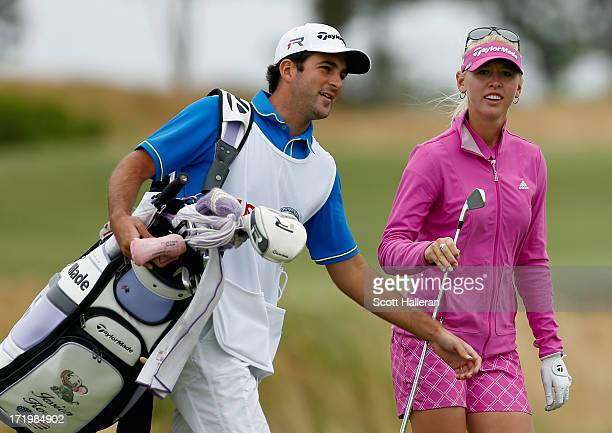 Jessica Korda walks with her boyfriend/caddie Johnny DelPrete during the final round of the 2013 US Women's Open at Sebonack Golf Club on June 30...