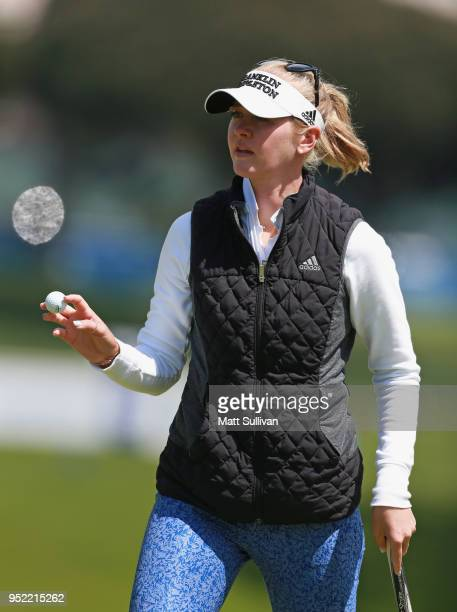 Jessica Korda waves to the gallery after making a par on the 18th hole during the second round of the Mediheal Championship at Lake Merced Golf Club...